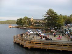 """Town Docks (Meredith, NH): Town Docks is the place to be in Meredith, N.H. during the summer, offering lake-side outdoor seating on Lake Winnipesaukee, free tie-ups to come by boat, and a sandy outdoor Tiki Bar where you can dig in your toes and relax by the water.""""  - http://www.thecman.com/"""