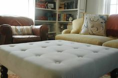 Tufted ottoman from a coffee table.