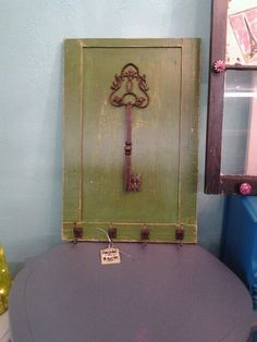 Old Cabinet Door...I picked up 2 at auction and I'm looking for ideas to make them useful/sellable-I like this one
