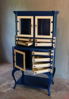 Vintage Dental Cabinet.   Love this....would be outstanding in a lighter color. I'll have to keep my eye open for one of these. Price...bit steep.