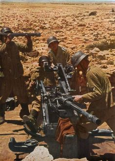 German soldiers of the Afrika Korps man a flak cannon to ensure a strong defense of their position from British airplanes. Tunisia, 1942.