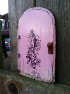 Hey, I found this really awesome Etsy listing at http://www.etsy.com/listing/114272899/pinkpurple-fairy-door-rising-fairy