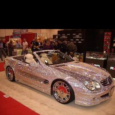 Glitter Mercedes Convertible .... :O ... Maybe my camaro needs a pink GLITTERY paint job instead of just pink??? :D :D :D --->that's a great idea!