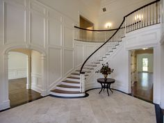 I love the picture frame molding used in the foyer of this home