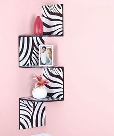 I don't know about zebra print but i love this shelf idea for the corner of a room!