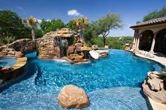 Free form pool, natural accents, boulders, grotto, JewelScapes Agean Blue