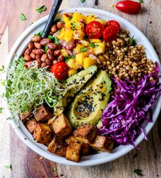 This gf, vegan buddha bowl is incredible - fried buckwheat groats, tofu, mango salsa, avocado, beans, greens, and a spectacular dragon dressing drizzle!