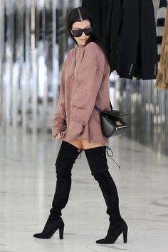 Kourtney Kardashian slaying it in black thigh high boots and Yeezy Season oversize mauve sweater