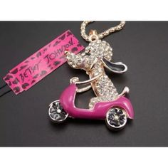 Very cute  Betsey Johnson poodle on a motorbike 28 inch long pooled on a motorbike. Betsey Johnson Jewelry