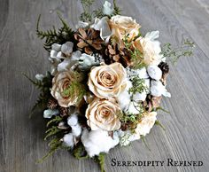 Pine cones, raw cotton and preserved roses are mixed with ferns, wheat, and ivory hydrangea to form the various bouquets and boutonnieres. Description from serendipityrefined.com. I searched for this on bing.com/images