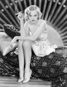 BELLE BENNETT – SITTING IN SILKY DRESS SMOKING WITH CIGARETTE HOLDER –1920s