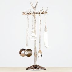 Designed with a nod to nature, #WorldMarket's Twig Bar Tool 5-Piece Set is a delightful and stylish addition to your bar for home entertaining. This barware set features a double jigger, bottle opener, bar knife, bar spoon, and the decorative stand.