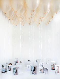 String up some of your fave photos for a chic balloon chandelier display at your 30th birthday bash.