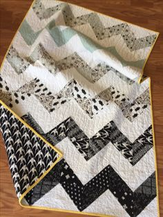 Cotton + Steel black and white patterns in half square triangle chevrons
