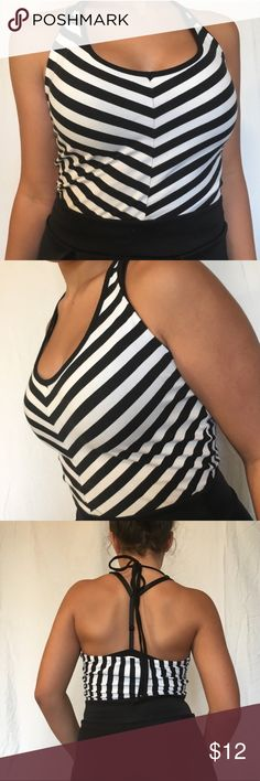 ✨STORE CLOSING ✨ Striped Halter Crop Top Black and white halter top with neck tie. Has a very unnoticeable pink stain on bottom hem. From delias. Pairs well with high waisted jeans. From a smoke/pet free home. Price is negotiable ❤️ Urban Outfitters Tops Crop Tops