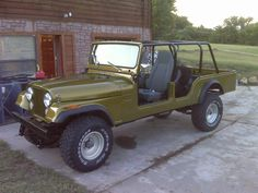 This is 1973 Four Door Scrambler.  Cut up the bodies from 3 CJ5s and the frames from two to build this Jeep.  The front doors were built to resemble a CJ7 front door.  The rear doors are stock CJ5 doors.  The bed was extended 14 inches to resemble a CJ6 or CJ8.  The floors, bulkhead, and fender wells were made from scratch.  The engine is an AMC 360 with rv cam, Edelbrock SP2P intake, and Holley Street Avenger 570 Carb.  The transmission is a T150 3 speed.