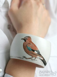 Natural wooden bracelet ornamented with hand-painted jay by SkadiaArt