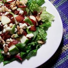 Totally tried this last night. Granny Smith apples, bleu cheese, balsamic vinaigrette, pecans, bacon, and romaine :)