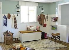 diy mudroom, laundry rooms, storage ideas, DIY a mudroom by adding a wooden wall treatment and beefy rod iron hooks with an added storage bin for shoes #woodenshoerack
