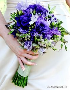 Shades of purple lisianthus and freesias wedding bouquet