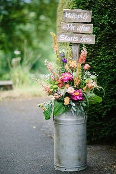 beautiful milk churn flower arrangements for the church with cute Happily Ever After Starts