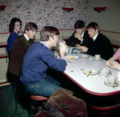 The Beatles at a meal break in a canteen, 1963. Photo: Paul Popper/Popperfoto, Getty Images