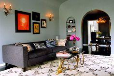 Kishani Perera living room, moroccan rug, ikat pillow, gray couch, rams head table