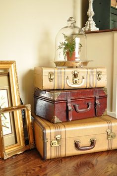 Jennifer Rizzo: cute arrangement of vintage suitcases, like the cloche on the silver tray too