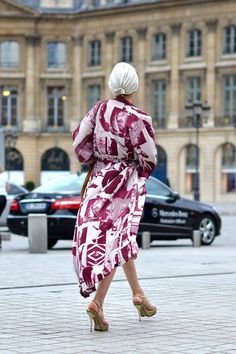 Catherine Baba dons her signature turban and printed robe on the way to Givenchy.