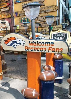 California Redwood Signs plays to the home team's fans with its decorative entryway decor, one of many items set for sale at its State Fair booth. (Chieftain photo by Chris McLean, 8/21/2012)