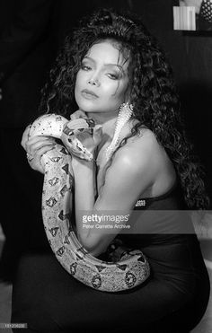 American singer La Toya Jackson poses with a snake during a press conference to promote her upcoming appearance in Playboy Magazine in 1989 in New York City.