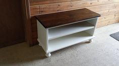 Nice entry way shoe bench with turning feet    36L X 13D X 20H    made out of pine    Solid white paint bottom -no distressing  Stained seat