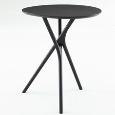 A table with interlocking branch-like legs by design collective Outofstock has been put into production by French brand Ligne Roset. Called Black Forest, the design was shown by Outofstock with a stainless steel top in Cologne last year (see our earlier story). The circular table-top sits on two interlocking Y-shaped legs. Photographs are by Ligne