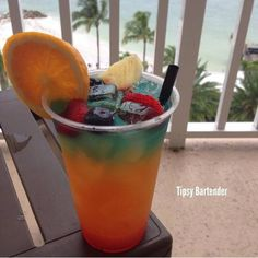 Rainbow Breeze Cocktail - For more delicious recipes and drinks, visit us here: www.tipsybartender.com