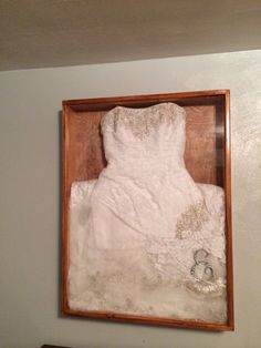 My wedding dress with my vail garter and cake topper in a shadow box that my husband made me :)