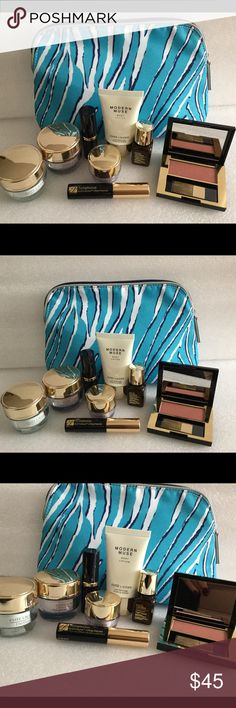 Estée Lauder makeup  Set Tavel size Estée Lauder set. You get 8 NEW Products in a beautiful makeup bag. U get: 1 Modern Muse cream, 1 black mascara, 1 lipstick color A65 intense Nude, 1 daywear cream, 1 advance time zone cream. 1 eye cream advance time zone,, 1 advance night repair serum and 1 Blush color Robel Rose Estee Lauder Makeup Eyeshadow