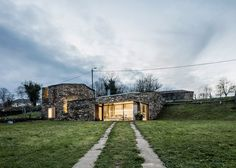 Barcelona-based Cubus Arquitectura has transformed an old stone wine cellar in Galicia, Spain, into a family home