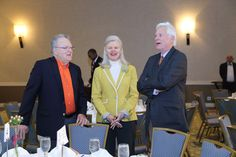 "Dick and Linda Fisher sharing a laugh with another guest at ""Jimmy Miller's Bracket Breakfast for Piedmont CASA"" on March 14, 2016. Image by Jennifer Byrne Photography."