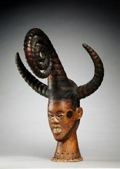 Headdress   Headdress, early 1900s      Guinea Coast, Nigeria, Ejagham , early 20th century      wood, antelope skin, bone, basketry, cane, metal, Overall - h:67.30 w:43.20 d:43.20 cm (h:26 7/16 w:17 d:17 inches).