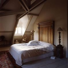 Here is another adult bedroom for you to critique.    Is there enough natural light? Too much wood? Are the soft furnishings too dull? Or is it perfect as it is?    Let us know your thoughts!