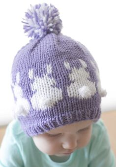 Knitting Pattern for Easter Bunny Hat - This baby hat features fair isle Easter Bunnies complete with fluffy white tails. Sizes 0-3 months, 6 months, 12 months and 2T+. Designed by Cassie at Little Red Window.
