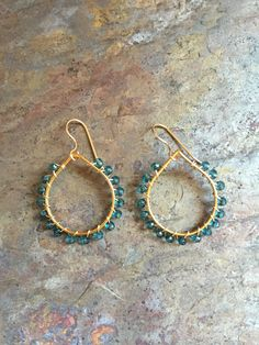 A personal favorite from my Etsy shop https://www.etsy.com/listing/458459782/gold-hoop-earrings-with-blue-quartz