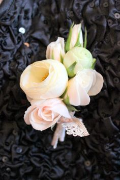 Wedding Corsage:  White Spray Roses and White Ranunculus with a lace tie    Ruby Reds Floral  Garden