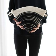 Our handle clutch is the perfect everyday bag or fancy evening clutch. Its unique shape will comfortably fit all your essentials and more. The bottom of the clutch is dyed in a black like tie dye pattern and the top is natural ivory. The bag comes with a zipper and a stylish tassel.  Mia Mélange bags are made from 100% cotton rope which we carefully sew together in a coiling technique. The cotton is grown locally in South Africa by farmers who are members of the Better Cotton Initiate (BCI). Tie Dye Patterns, Everyday Bag, Cotton Rope, Ikat, Clutch Bag, Tassels, Essentials, Ivory, Handle