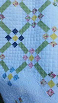 Details of Sisters Attic Quilting on the Baby 9s quilt.
