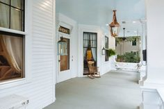 Southern fixer upper home renovation makeover - Classic Southern porch with wood planked ceiling in haint blue - Benjamin Moore paint colors in post.