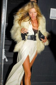 She wore a fur coat and belted white dress on her 33rd birthday for a night our in London.