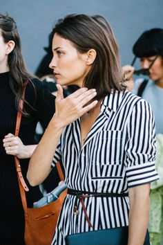 Maria Duenas Jacobs wearing stripes at Fashion Week in New York | @andwhatelse