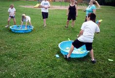 Sponge splash carnival game - who can get the most of their colored sponges in their opponent's pool before time runs out?