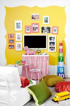 Love this Kids Playroom with their pictures on the wall.